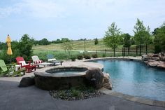 A relaxing custom pool and patio perfect for fun in the sun and getting the perfect tan. Photos taken by Dempsey Ward. (Home Design & Decor by B.L. Rieke & Associates, Inc.) Visit us at blrieke.com