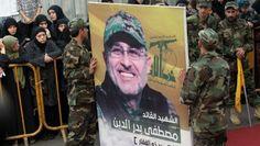 Members of Lebanon's Shiite militant group Hezbollah carry a portrait of Mustafa Badreddine in Beirut on May 13, 2016. (AFP/ ANWAR AMRO)
