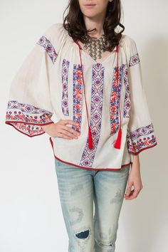 Peasant top blouse embroidered in vibrant hues of blue, orange, and red with tie at neck.   Pisco Peasant Top by Kas. Clothing - Tops - Blouses & Shirts Louisiana