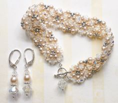 Bridal Lace: Bracelet + earring set.  Sterling silver toggle, Swarovski crystals, + pearl beads.  Delicate lace pattern formed from handmade, needle + thread work. www.aebumble.com