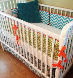 Shelby Cannon : DIY Crib Bumpers in two fabrics. Total 4 yards + 1.5 yards for piping. I did a simple ruffle along the top edges instead of piping. Way faster!