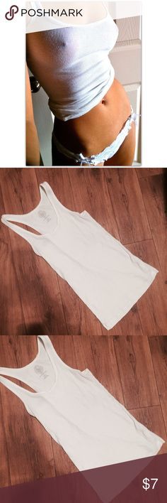 Vintage White Wife Beater Tank  Vintage White Wife Beater Tank. Size large. Ultra white thin material, rubbed texture. NWOT. 90's style Vintage Tops Tank Tops