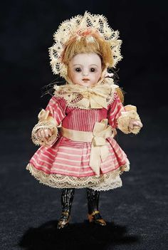 "German All-Bisque Miniature Doll,886,by Simon and Halbig in Original Dress 5"" (13 cm.)"