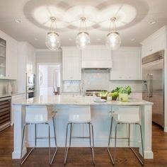 Rejuvenation's Hood classic globe pendants provide radiant beams of light when grouped together in multiples or alone.