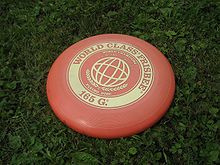A flying disc is a disc-shaped gliding object or toy that is generally plastic and roughly 20 to 25 cm (7.9 to 9.8 in) in diameter with a lip, used recreationally for throwing and catching, for example, in flying disc games. The shape of the disc, an airfoil in cross-section, allows it to fly by generating lift as it moves through the air while spinning. The term Frisbee, often used capitalized to generically describe all flying discs, is a registered trademark of the Wham-O toy company.