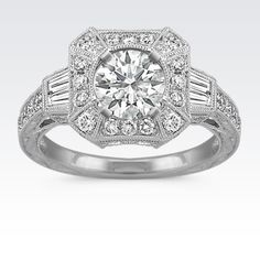 Modern meets vintage in this breathtaking engagement ring with milgrain detailing. Crafted in quality 14 karat white gold and boasting four baguette diamonds, at approximately .25 carat TW, and 46 round diamonds, at approximately .80 carat TW, these sparkling pavé-set gems await the center stone of your choice. The total gem weight is approximately 1.10 carats.