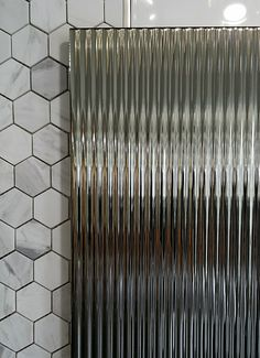 Dadu Decor is a 760x250mm chrome coated ceramic tile, ideal for wall features.  Retails: $77each.