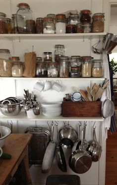 16 house: A LITTLE FIND | Like that this is a more realistic version of how open shelves would look in a used kitchen.