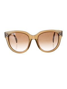 Olive green Céline sunglasses with tonal lenses and logo pieces at temples.