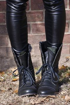 combat boots + leather leggings. Like how the boots are tied half way up to give it that lazy look