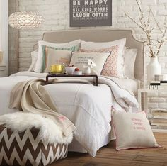 Bedroom idea: taupe and white everything. Mixed textures, chevron pouf. I would kill for a white brick wall too!: