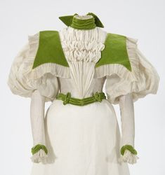 White silk bodice with green velvet trimming. Made by dressmaker Alice Mendenhall, St. Paul, Minnesota.