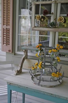 Mary Alice outdoor room aka porch with a french bottle drying rack,  I just got me one of these too :)