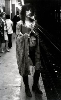 """Patti Smith, 68th St. subway stop, New York City, 1971, by Gerard Malanga. """"My great quandary was what coat to wear and which books to bring."""" ~ Patti Smith, M Train"""