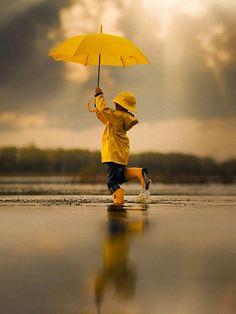 'Dancing In The Rain' by Jake Olson Studios. Yellow umbrella○ 'Dancing In The Rain' by Jake Olson Studios. Foto Picture, Photo D Art, Walking In The Rain, Singing In The Rain, Rain Photography, Children Photography, I Love Rain, Yellow Umbrella, Parasols