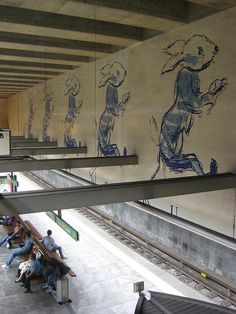 "Picture of an underground station in Lisbon, ""Cais do Sodré"". In fact, this panel is amazing because it depicts a scene from ""Alice in Wonderland"" - the hare running and saying ""I'm in a hurry"". Wonderful!"