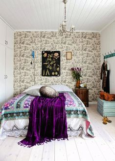 Not quite enough color for me, but still a fantastic boho vibe. Love the paper and bedding!