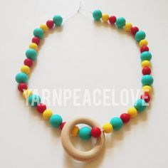 Colorful Silicone Teething Necklace with Wood Ring by YarnPeaceLove, $25.00