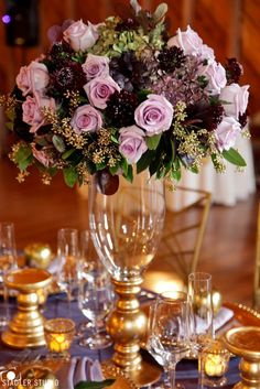 Purple and gold centerpiece with Roses, Scabiosa, Hydrangea