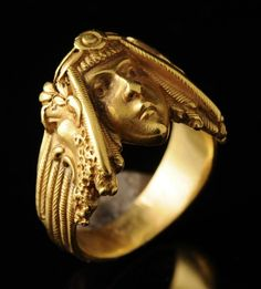 This Art Nouveau gold ring is kind of cool, don't you think?
