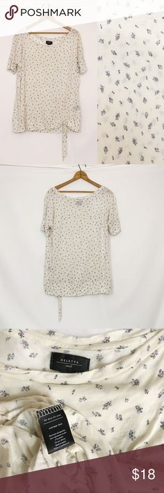 "DELETTA floral printed tied hem top Excellent condition! Ties at waist, modal. Dark mark on photos 1 & 2 are black side seam content tag, which may be removed after purchase. Bust 46"" length 25"" will fit larger sizes, but sleeves will be tight after a 10"" circumference. Should fit up to 14"" reasonably. Anthropologie Tops Tees - Short Sleeve"