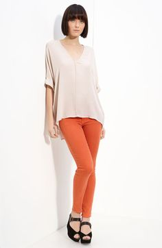 Great blouse with some colored/wax coated jeans.