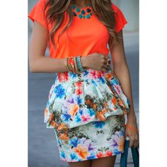 A SPORTY NEON TOP WITH A TROPICAL FLOWER SKIRT