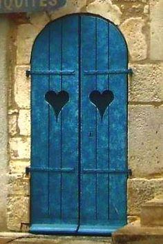 Blue shutters with hearts Cool Doors, Unique Doors, Knobs And Knockers, Door Knobs, Entrance Doors, Doorway, Porte Cochere, When One Door Closes, Closed Doors