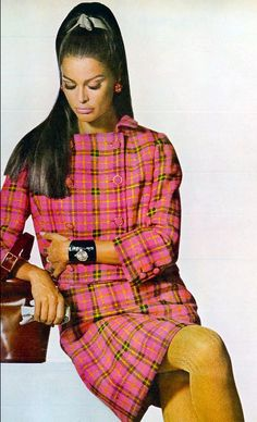 1967 Editha in an electronic-pink plaid suit-dress with double breasted jacket by Jack Sarnoff, watch by Longines, handbag by Hermes, photo by Penn, Vogue