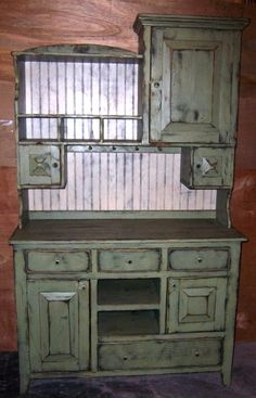 "This beautiful Farmhouse Cupboard Hutch will give you tons of storage space.  It comes with  5 cupboards, 4 drawers and shelves through out the unit.  The piece will fit in either your country kitchen as a cupboard or dinning room as a hutch.  Let your imagination lead the way.    The farmhouse cupboard is a very unique piece of furniture that would add that special touch to your country rustic primitive home decor.    Measures approximately 82"" H x 48"" W x 20"" D."