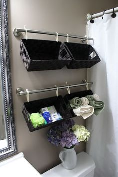Hang these baskets over the toilet to store toiletries, wash cloths or hand towels and they look good doing it. http://hative.com/over-the-toilet-storage-ideas-for-extra-space/