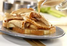 These simple turkey sandwiches are made with leftover roast turkey or turkey from the deli counter. Served hot, with knife and fork and plenty of gravy, they're really good!....Turkey breast and cook in crock pot...
