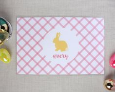 A fun Easter themed personalized placemat to dress up your kitchen table. An illustrated easter bunny is featured prominently on the center