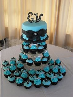 Chocolate cupcakes and cutting cake for an engagement.  All decorations are fondant.