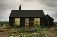 Black Houses: The Pros and Cons of a Dark Painted Facade - Gardenista Black House Exterior, Cottage Exterior, House Paint Exterior, Facade Design, Exterior Design, Paint Your House, Dark House, Yellow Doors, Yellow Houses