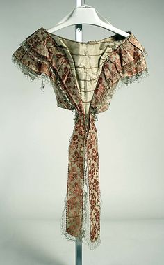 1858. Evening bodice that is part of the three piece set of skirt, evening bodice and basque.