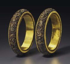 A RARE PAIR OF GOLD-INLAID CARVED CHENXIANGMU WOOD BANGLES -  LATE QING DYNASTY.