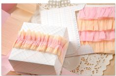 Ruffled Crepe Paper {Gift Wrap}---lots of great ideas here for do-it-yourself gift wrapping. They look so easy I think even I could do this.