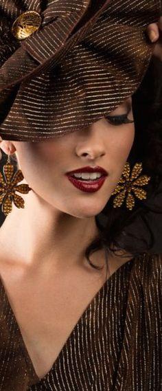 Glamorous women delight in wearing a beautiful chapeau