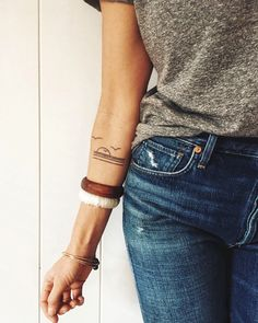 Arm stack, grey tee, comfy vintage fit jeans, and new ink.