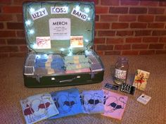 Den's Merch Table on Pinterest | Suitcases, Suitcase Display and ...