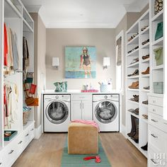 large walk-in closet with built-in laundry station