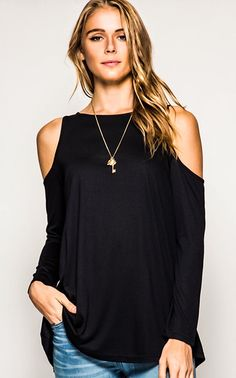 Everyone needs a Mia in their closet! This black top is a showstopper with its flattering, loose fit, and trendy open shoulders. It is made of a super soft, quality knit, and fits true to size. FREE S