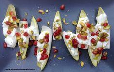 recept voor een snel hapje voor oudejaarsavond witlof gevuld met mozzarella granaatappel en pistache