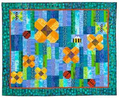 """Secret Garden Quilt ~ Strips and simple piecing techniques come together like a puzzle to reveal a garden bursting with color and life. The finished quilt size is 57"""" x 47""""."""