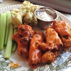 Restaurant-style buffalo chicken wings can be prepared in the comforts of your own home with a few simple ingredients.