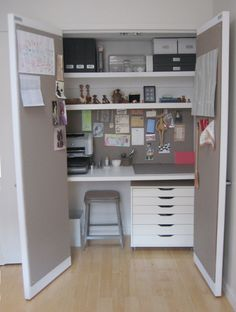 Office in a closet! Love the bulletin board doors