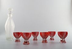 """6 p. Glassware, decanter and 6 cocktail / vodka glass """"Strict"""", Bengt Orup.  p. Glassware, decanter and 6 cocktail / vodka glass """"Strict"""", Bengt Orup, Johansfors. Designed in 1952. Height 30 cm. Glass 7,5 x 6 cm."""