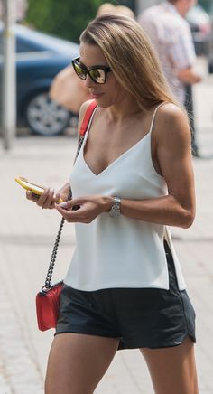 Street style, casual outfit, sexy outfit, spring chic, summer chic, white top, black shorts, red small bag
