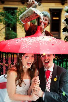 Show that you can weather life's storms together under a ceremonial umbrella | Offbeat Bride